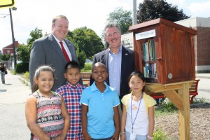 Children in front of Little Free Library in Lowell